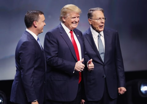 Republican presidential candidate Donald Trump is introduced with Chris Cox (L), Executive Director of the NRA Institute for Legislative Action and Wayne LaPierre (R), Executive Vice President of the National Rifle Association, at the National Rifle Association's NRA-ILA Leadership Forum during the NRA Convention at the Kentucky Exposition Center on May 20, 2016 in Louisville, Kentucky. The NRA announced their endorsement of Trump at the convention. The convention runs May 22. (