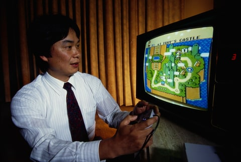 Shigeru Miyamoto, creator of Mario and other characters and video games for Nintendo, plays Super Mario World on a Nintendo Super NES System.