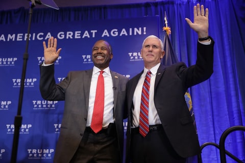 Dr. Ben Carson (L) and Republican vice presidential nominee Governor Mike Pence wave during a campaign event at the DoubleTree by Hilton November 1, 2016 in Valley Forge, Pennsylvania. Pence and presidential nominee Donald Trump both highlighted what they see as the failures of Obamacare.