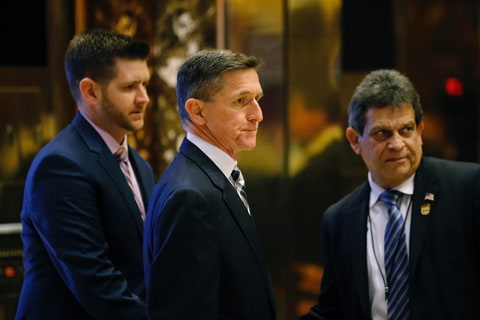 Retired Lt. Gen. Michael Flynn(C) arrives at the Trump Tower for meetings with US President-elect Donald Trump, in New York on November 17, 2016.