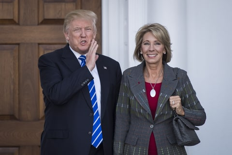 BEDMINSTER TOWNSHIP, NJ - NOVEMBER 19: President-elect Donald Trump stands with Betsy DeVos after a meeting at Trump National Golf Club Bedminster in Bedminster Township, N.J. on Saturday, Nov. 19, 2016.