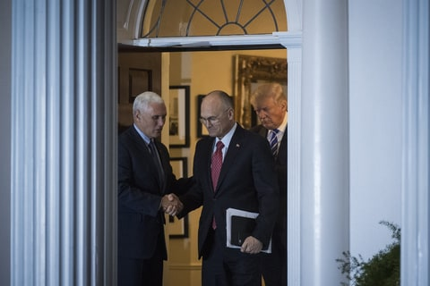 President-elect Donald Trump, Vice President-elect Mike Pence and Andy Puzder, chief executive of CKE Restaurants, walk out at the clubhouse at Trump National Golf Club Bedminster in Bedminster Township, N.J. on Saturday, Nov. 19, 2016.
