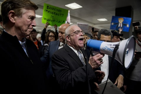 From left, Rep. Don Beyer, D-Va., Rep. John Delaney, D-Md., Rep. Gerry Connolly, D-Va., and Rep. Jamie Raskin, D-Md., (not pictured here) speak to the press and protesters about possible detention of travelers and legal access at Dulles International Airport in Virginia on Sunday, Jan. 29, 2017. Protests erupted at airports around the country following President Trump's executive order restricting travel from several Islamic countries.