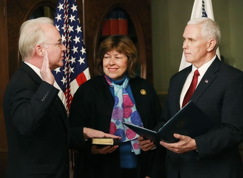 U.S. Vice President Mike Pence (R) swears in Rep. Tom Price (R-GA)(L) as new the Health and Human Services Secretary, as his wife Betty Price holds a bible, on February 10, 2017 in Washington, DC. Yesterday Price was confirmed by the U.S. Senate.