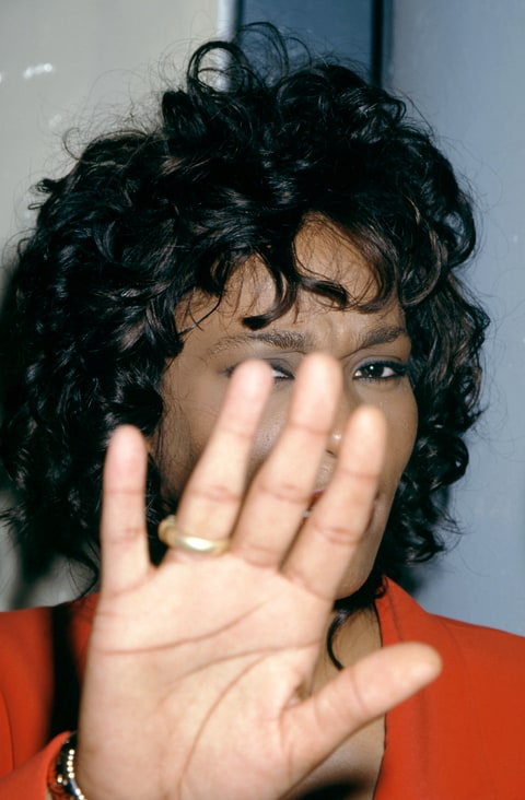 LOS ANGELES, CA - 1995: American singer and actress Whitney Houston (1963-2012) hides her face from the cameras circa 1995 in Los Angeles, California.