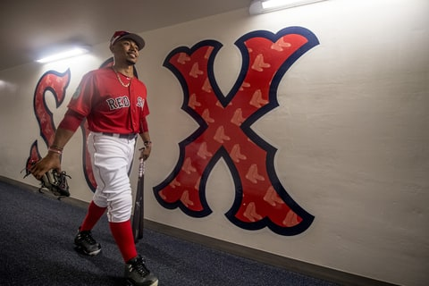 Mookie Betts #50 of the Boston Red Sox walks through the hallway on his way to the field before a Spring Training game against the Tampa Bay Rays on March 2, 2017 at Fenway South in Fort Myers, Florida .