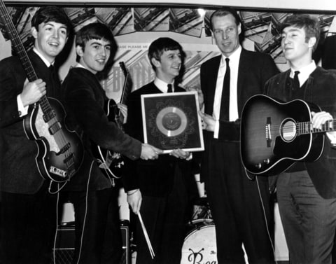 1964: Rock and roll band 'The Beatles' poses for a portrait with their producer George Martin. (L-R) Paul McCartney, George Harrison, Ringo Starr, producer George Martin, John Lennon.