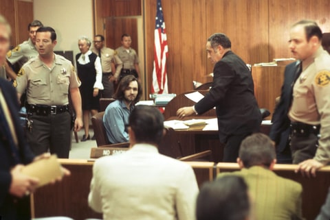 Charles Manson sits in the courtroom during his murder trial in 1970 in Los Angeles, California.