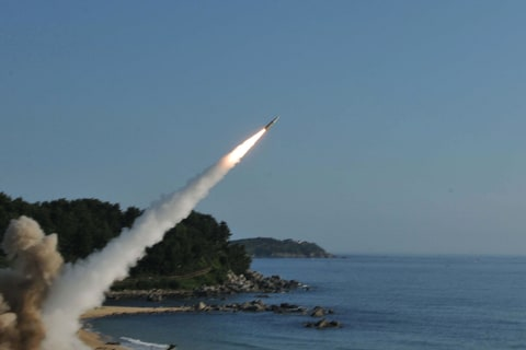 In this handout photo released by the United States Forces Korea, U.S. M270 Multiple Launch Rocket System (R) firing an MGM-140 Army Tactical Missile during a U.S. and South Korea joint missile drill aimed to counter North Korea¡¯s intercontinental ballistic missile test on July 5, 2017 in East Coast, South Korea. The U.S. Army and South Korean military responded to North Korea's missile launch with a combined ballistic missile exercise on Wednesday, into South Korean waters along the country's eastern coastline.