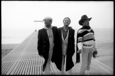 Photo of Charlie WILSON and Robert WILSON and Ronnie WILSON and GAP BAND; L-R: Ronnie Wilson, Robert Wilson, Charlie Wilson on the beach at Cannes, France