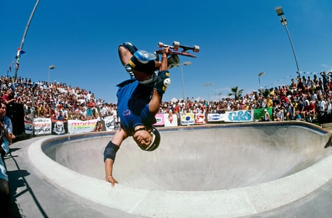 Steve Caballero, riding for Powell Peralta, does an invert above the keyhole pool during competition as the National Skateboarding Association event at the Del Mar Skate Ranch in August 1985 in Del Mar, California.