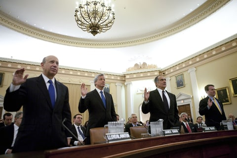 Leaders of four of the biggest U.S. banks including, left to right, Lloyd Blankfein, chairman and and chief executive officer of Goldman Sachs Group Inc., Jamie Dimon, chairman, president, and chief executive officer of JPMorgan Chase & Co., John Mack, chairman of Morgan Stanley, and Brian Moynihan, president and chief executive officer of Bank of America Corp., are sworn in before testifying at a hearing of the Financial Crisis Inquiry Commission (FCIC) in Washington, D.C., U.S., on Wednesday, Jan. 13, 2010.