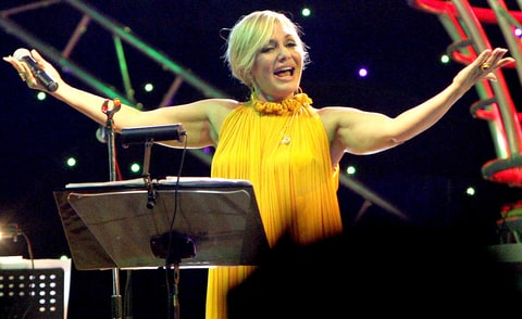 Iranian singer Googoosh, whose real name is Faegheh Atashin, salutes the audience during a rare concert she gave in the Iraqi Kurdish city of Arbil, 320 kms (200 miles) north of Baghdad, late on September 12, 2010. The popular Persian diva was banned from singing along with all female preformers in Iran after the establishment of the Islamic republic in 1979, but she resumed her performances abroad ten years ago.