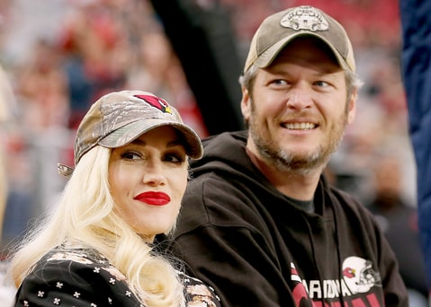 Gwen Stefani and Blake Shelton attend the NFL game between the Green Bay Packers and Arizona Cardinals at the University of Phoenix Stadium on December 27, 2015 in Glendale, Arizona.