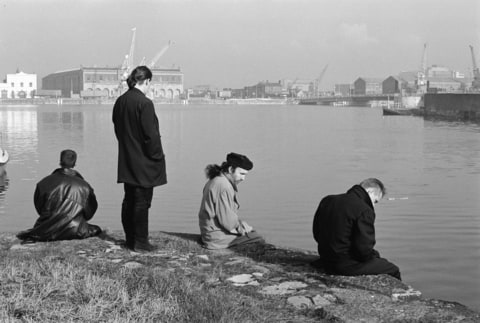 Archive photograph of world famous Irish rock band U2, pictured beside the River Thames during their visit to Britain as part of their 18 month world tour. (From left to right) lead guitarist David Evans, bassist Adam Clayton, drummer Larry Mullen and lead sin