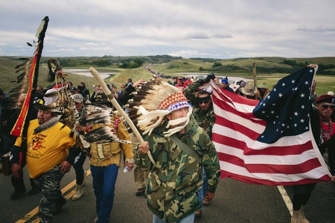 Catcher Cuts The Road, an Iraq War veteran, leads a protest march to a sacred burial ground at the Standing Rock Indian Reservation in North Dakota, Sept. 9, 2016. A federal judge on Friday denied the Standing Rock Sioux Tribe's efforts to halt the construction of a pipeline skirting the northern edge of the reservation on Friday; on the same day, the government ordered a the pipeline company to pause its work. (