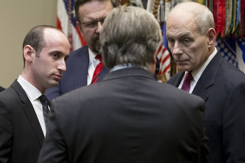 Senior Advisor to the President, Stephen Miller (L) and Secretary of the Department of Homeland Security John Kelly (R) listen to Chief Strategist and Senior Counselor Stephen Bannon (C) before a meeting with US President Donald J. Trump (not pictured) on cyber security in the Roosevelt Room of the White House, in Washington, DC, USA, 31 January 2017.