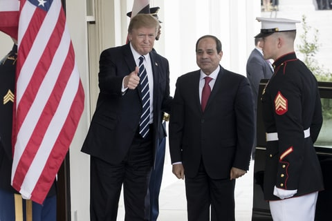 US President Donald J. Trump (L) gestures while greeting President of Egypt Abdel Fattah Al Sisi (center) at the entrance to the West Wing of the White House, in Washington, DC, USA, 03 April 2017.