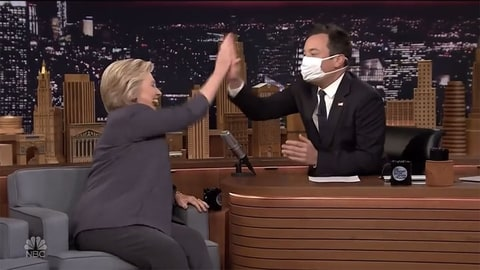 Hillary Clinton gives Jimmy Fallon a high five after he mocked her recent health scare