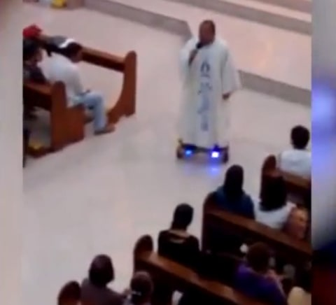 The hoverboarding priest.