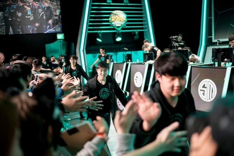 Immortals League of Legends team celebrating with fans at LCS last year