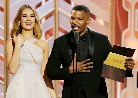 Lily James and Jamie Foxx on stage during the Golden Globe 2016.