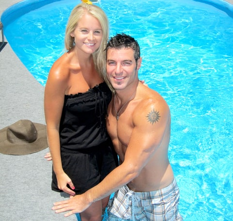 Jordan Lloyd and Jeff Schroeder pose for a photo at the pool for the HoH camera in 2011.