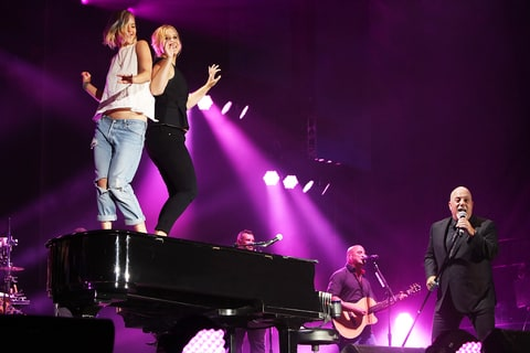 Jennifer Lawrence and Amy Schumer joined Billy Joel on stage.