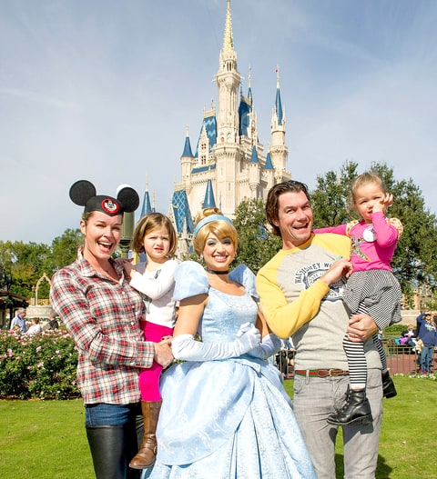 Rebecca Romijn and actor Jerry O'Connell marked their twin daughters' birthdays at the Magic Kingdom with a visit from Cinderella in front of Cinderella Castle at the Walt Disney World theme park December 28, 2012 in Lake Buena Vista, Florida.