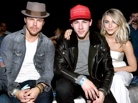 Derek Hough, Nick Jonas and Julianne Hough attend the DirecTV Super Saturday Night co-hosted by Mark Cuban's AXS TV at Pier 70 on February 6, 2016.