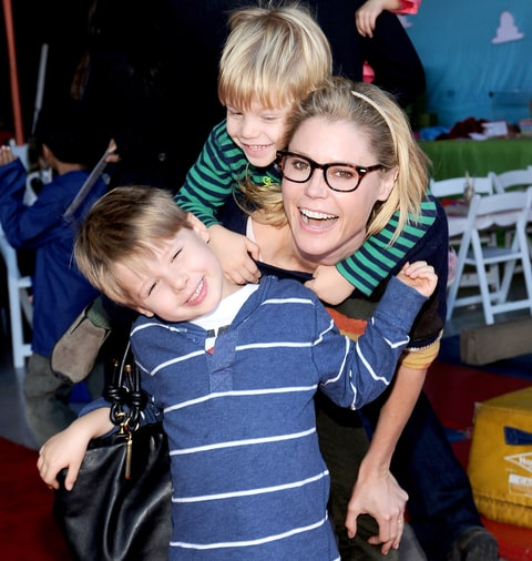Julie Bowen and sons attend a creative arts fair and family day.