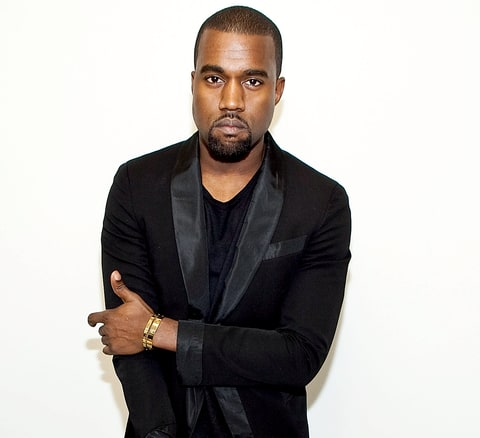 Kanye West poses for a photo at the Rodarte Spring 2011 fashion show during Mercedes-Benz Fashion Week.