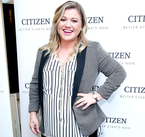 Kelly Clarkson attends Citizen Watch Company's New York Corporate Offices Grand Opening on November 3, 2015 in NYC.