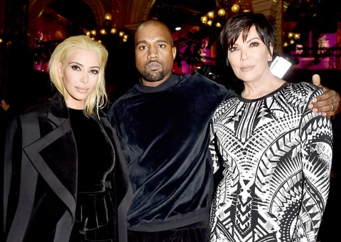 Kim Kardashian, Kanye West, and Kris Jenner attend the Balmain show on March 5.
