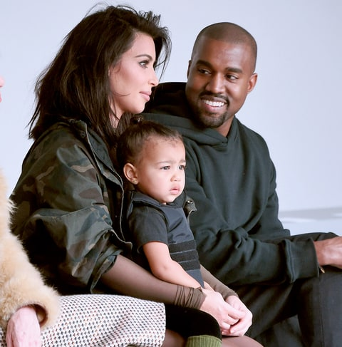 Kim Kardashian, North West and Kanye West attend the adidas show during Mercedes-Benz Fashion Week Fall 2015.