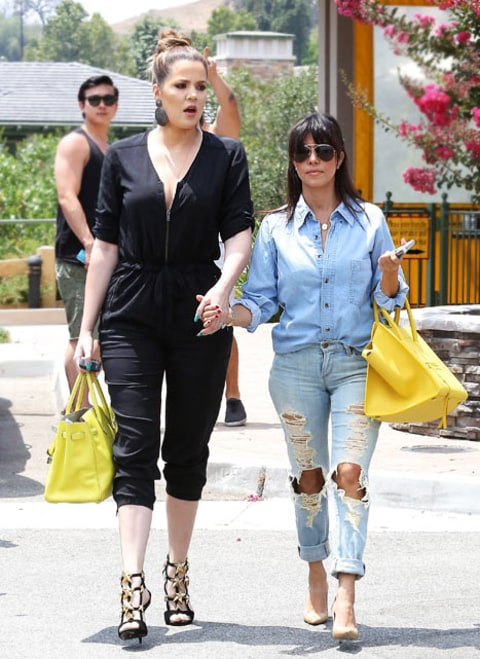 Kourtney and Khloe walking outside