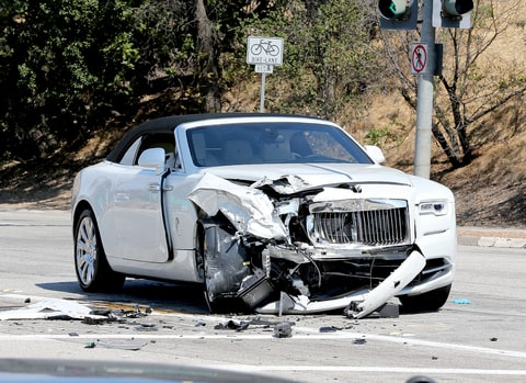 Scene from Kris Jenner car crash in Calabasas in her white Rolls-Royce into a green Prius,