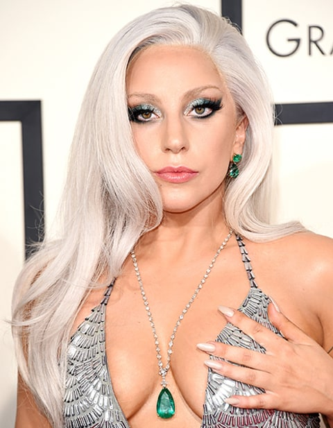 lady gaga covering dress with hand