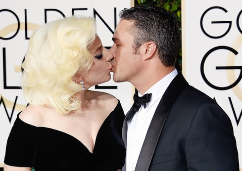 Lady Gaga and Taylor Kinney kissing at the Golden Globes 2016