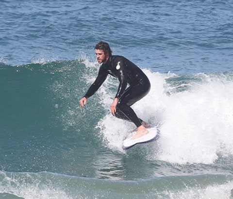 Liam Hemsworth surfing