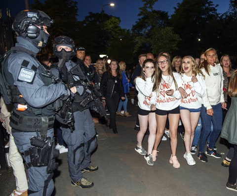 .Fans and armed police at the One Love concert, Manchester