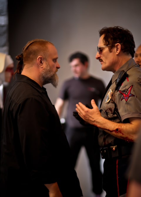 Crahan and Coates on set of 'Officer Downe.'