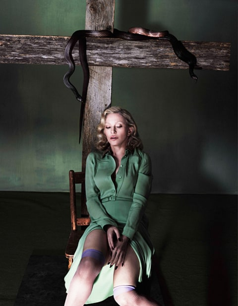 madonna sitting under a cross