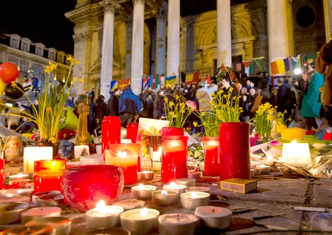 Hundreds of people gather at a makeshift memorial in front of Brussels' Stock Exchange on Place de la Bourse (Beursplein) on March 24, 2016.