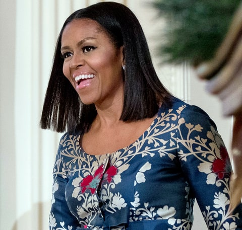First lady Michelle Obama arrives in the East Room of the White House during a preview of the 2016 holiday decor for military families, Tuesday, Nov. 29, 2016, in Washington.