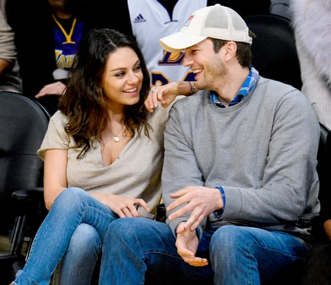 Mila Kunis and Ashton Kutcher attend a basketball game between the Oklahoma City Thunder and the Los Angeles Lakers at Staples Center on December 19, 2014.