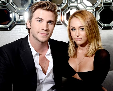Liam Hemsworth and singer Miley Cyrus pose during the Australians In Film Awards & Benefit Dinner at the InterContinental Hotel on June 27, 2012 in Century City, California.