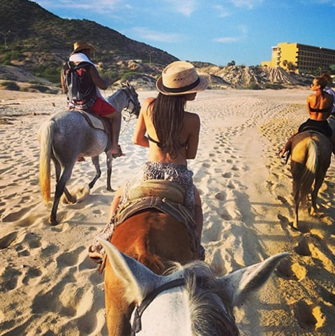 Naya Rivera on a horse back shot