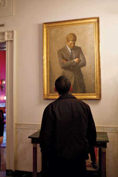 "Obama viewing a White House portrait of JFK. ""Once you're in this o ce, you are part of a legacy dating back to those  rst Revolutionaries,"" he says. ""And this amazing experiment in democracy has to be tended."""