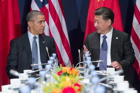 U.S. President Barack Obama, left, meets with Chinese President Xi Jinping on the sidelines of the COP21 United Nations Climate Change Conference in Le Bourget, outside Paris, Monday, Nov. 30, 2015
